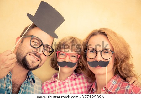 Family with fake mustache - stock photo