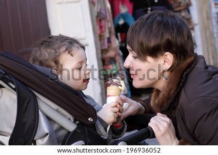 Family with ice cream on the street - stock photo