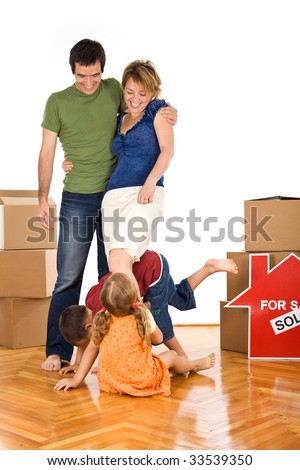 Family with kids having fun in their new home on the floor - isolated - stock photo
