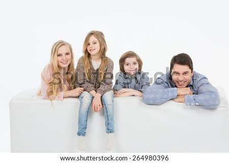 Family with kids on the couch white background - stock photo