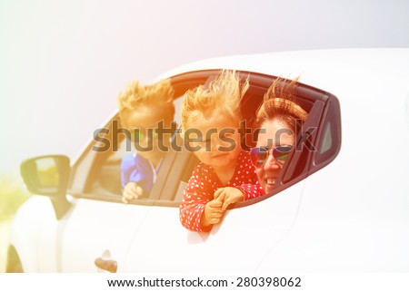 family with kids travel by car on summer vacation - stock photo