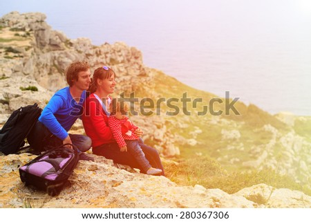 family with little child travel in scenic mountains