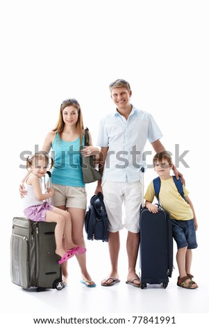 Family with luggage on white background - stock photo