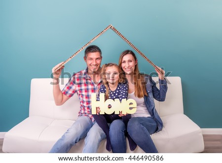 family with parents and daughter - stock photo