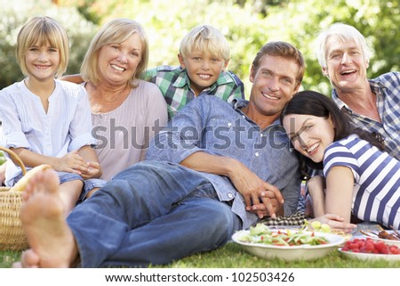 Family with picnic in park - stock photo