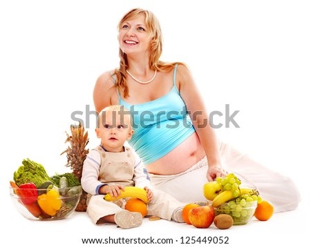 Family with pregnant woman and child preparing food. Isolated.