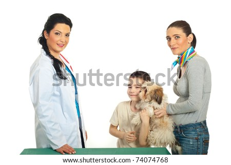 Family with puppy shih tzu visit veterinary doctor woman against white background - stock photo