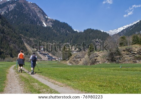 Family with senior parents hiking in the alps in Austria.