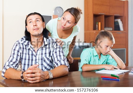 Family with teenager boy having quarrel at home - stock photo