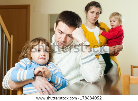 Family with two children having quarrel at home - stock photo