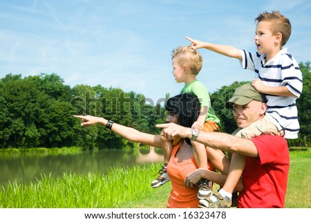 Family with two kids in vacation on a sightseeing trip - stock photo
