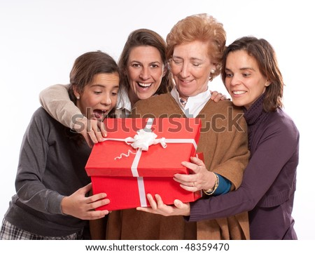 Family women in raptures over an open giftbox - stock photo