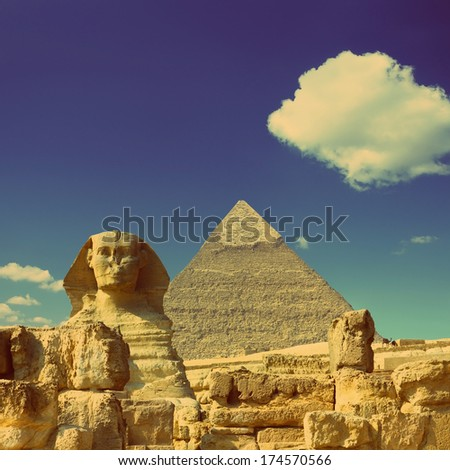 famous ancient egypt Cheops pyramid and sphinx in Giza - vintage retro style - stock photo