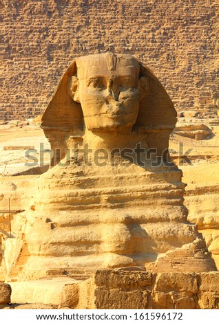 famous ancient egypt sphinx and pyramid in Giza - stock photo