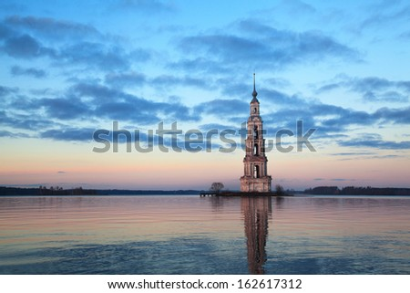 Famous and Beautiful Flooded Belltower on the River Volga at sunset. Kalyazin, Russia  - stock photo