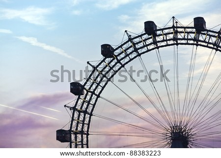 Famous and historic Ferris Wheel of vienna prater park at sunset - stock photo
