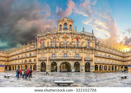 Famous and historic  Plaza Mayor in Salamanca at sunset with dramatic clouds, Castilla y Leon, Spain - stock photo