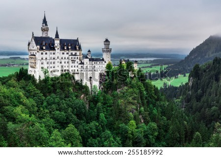 Famous Architecture and Landmark near Munich, Germany. Castle Neuschwanstein at Fuessen in Late Summer on a cold and wet day. Amazing Hill Landscape - stock photo