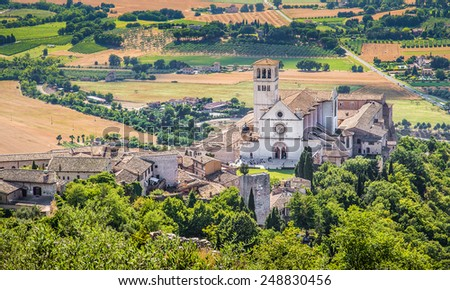 Famous Basilica of St. Francis of Assisi (Basilica Papale di San Francesco) at sunset in Assisi, Umbria, Italy - stock photo