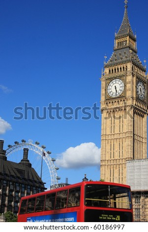 Famous Big Ben clock tower with London eye and bus, in London, UK. - stock photo