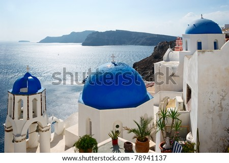 Famous Blue Domed churches on the sea background in Santorini, Greece. - stock photo