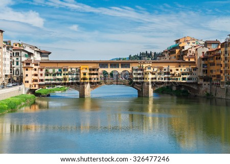famous bridge Ponte Vecchio over waters of  river Arno, Florence, Italy