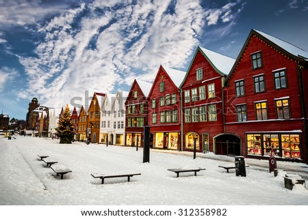 Famous Bryggen street with wooden colored houses in Bergen at Christmas, Norway - stock photo