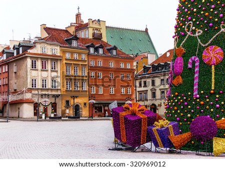 Famous castle square of Warsaw with colorful medieval houses, christmas tree and gifts. Old  town. Winter. Poland. Travel, vacation, new year, christmas concept. Copy space. Place for you message.  - stock photo