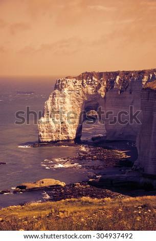 Famous chalk cliffs at Cote d'Albatre (Alabaster Coast). Etretat, France. Toned photo.  - stock photo