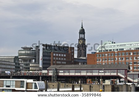 famous church St Michaelis looking over the harbor of Hamburg - stock photo