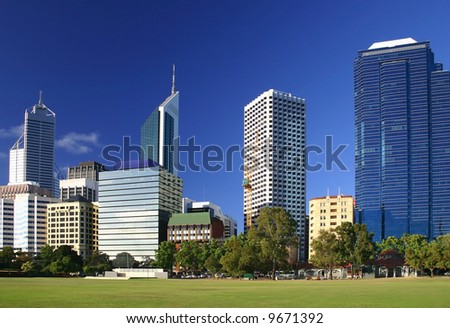Famous city buildings with beautiful azure sky. Perth, Western Australia. - stock photo