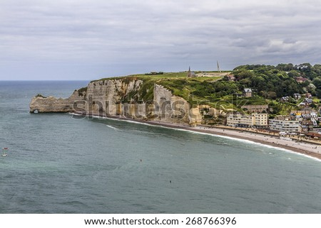 "Famous cliffs ""d'Amont"" of Etretat. Etretat is a commune in the Seine-Maritime department in the Haute-Normandie region in northwestern France. Etretat is now a famous French seaside resort."