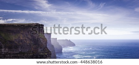 famous cliffs of moher, west coast of ireland at wild atlantic ocean