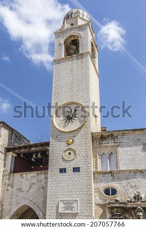 Famous clock tower of Dubrovnik, Croatia. Tower was built in Main Street of Old city Dubrovnik - Stradun in 15 Century. Dubrovnik is one of most prominent tourist destinations in Mediterranean. - stock photo
