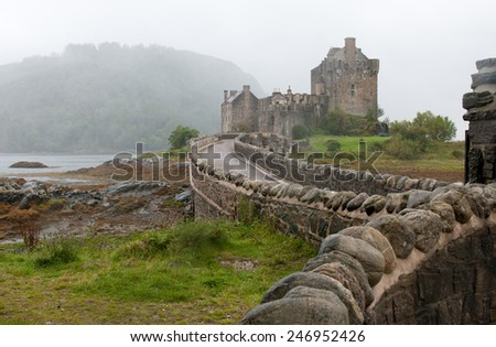 Famous Eilean Donan Castle at  loch Alsh lake in the Highlands of Scotland - stock photo