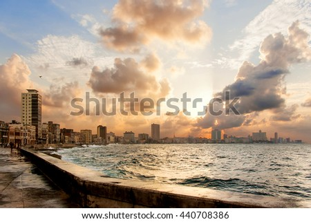 Famous embankment promenade Malecon at sunset. Havana, Cuba. - stock photo
