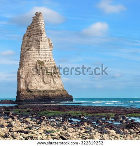 Famous  Etretat steep cliff in Atlantic ocean, Normandy, France - stock photo