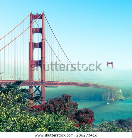 Famous Golden Gate Bridge. The bright blue sky. Coastline of California. Vintage filter - stock photo