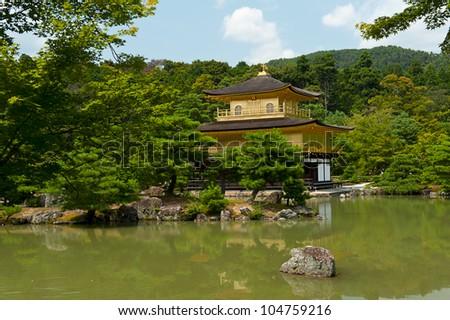 Famous Golden Pavilion Kinkaku-ji in Kyoto Japan and its surrounding beautiful park. - stock photo