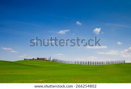 Famous hills of Tuscany, Farmland in Val d'Orcia - stock photo