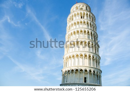 Famous leaning tower of Pisa during summer day - stock photo