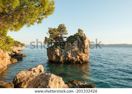 Famous little island near Brela coast, Dalmatia, Croatia - stock photo