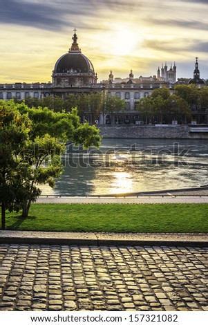Famous Lyon city at sunset with Rhone river - stock photo