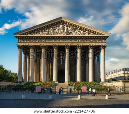 Famous Madeleine church under dramatic sky, Paris, France - stock photo