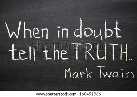 """famous Mark Twain quote """"When in doubt tell the truth"""" handwritten on blackboard - stock photo"""