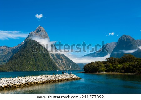 Famous Mitre Peak rising from the Milford Sound fiord. Fiordland national park, New Zealand - stock photo