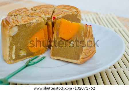 Famous moon cake with assorted nuts and yolk - stock photo