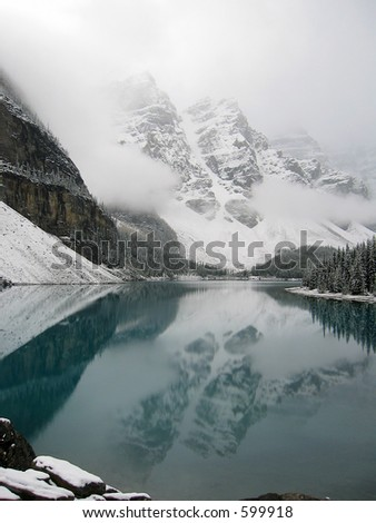 famous moraine lake in canada after a snow storm - stock photo