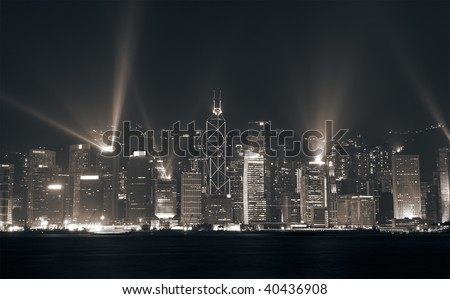 Famous night scenes of rays show on Victoria Harbor in Hong Kong. - stock photo