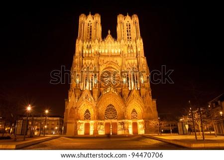 Famous Notre-Dame de Reims at night, UNESCO World heritage site - stock photo